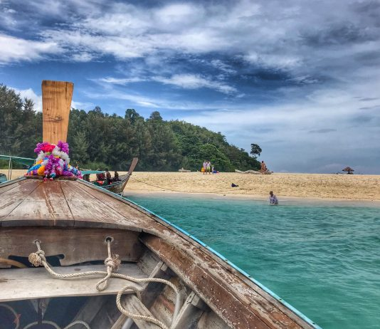 bamboo island water and boat